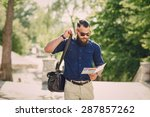 bearded man travels with map | Shutterstock . vector #287857262