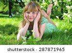 little girl lies on green grass ...   Shutterstock . vector #287871965
