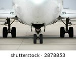 Airplane front view at the airport showing landing gear - stock photo