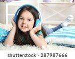 beautiful little girl listening ... | Shutterstock . vector #287987666