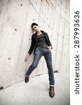 attractive man dressed in jeans ... | Shutterstock . vector #287993636