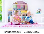 Kids Playing With Doll House...