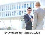 businesswomen shaking hands... | Shutterstock . vector #288106226