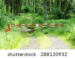 barrier gate on rural path with ...
