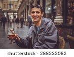 happy man drinking bear on the... | Shutterstock . vector #288232082
