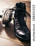 men's goods  old boots dumbbells | Shutterstock . vector #288341525
