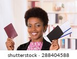 black office woman holding up... | Shutterstock . vector #288404588