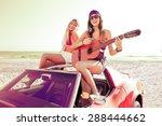 Girls Having Fun Playing Guita...