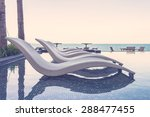 resort pool with umbrella and... | Shutterstock . vector #288477455