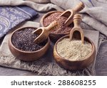 Stock photo red black and white quinoa seeds on a wooden background 288608255