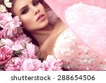 Stock photo beautiful girl in the flower garden princess 288654506
