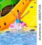 child on water slide at... | Shutterstock . vector #288829106