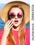 Small photo of Outdoor fashion portrait of young happy pretty smiling woman,having fun on the beach, wearing stylish chick outfit hat and sunglasses,positive mood.summer accessorize,summer sunglasses.show emotions