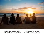 Silhouettes Of  Group Of...