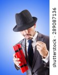 Small photo of Businessman with dynamite against the gradient