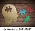 Stock photo puzzle head brain concept human head profile made from brown paper with a jigsaw piece cut out 289107095