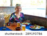 a young woman enjoying a meal... | Shutterstock . vector #289193786