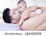portrait of young man lying on... | Shutterstock . vector #289308098