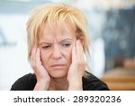 very worried middle aged woman | Shutterstock . vector #289320236