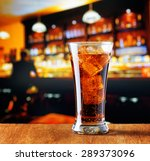 glass of cola with ice in a bar. | Shutterstock . vector #289373096