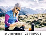 Young Woman Hiker Reading And...