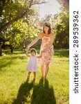 mother and daughter in the park | Shutterstock . vector #289539362