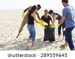 group of volunteers tidying up... | Shutterstock . vector #289559645