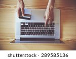 hands holding credit card and... | Shutterstock . vector #289585136