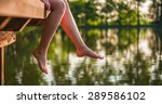 woman relaxes by the lake... | Shutterstock . vector #289586102