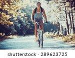 Woman Riding A Mountain Bike I...