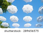 white umbrellas canes in the sky | Shutterstock . vector #289656575