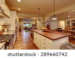 Stock photo classic kitchen with hardwood floor an island and connected dinning room and living room 289660742