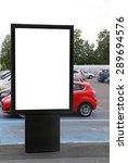 Blank billboard on a parking lot  - stock photo
