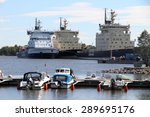 HELSINKI, FINLAND - JUNE 5, 2015: Photo of three icebreakers docked in the port  - stock photo