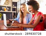Two Women Using Computers In A...