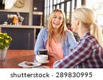 two female friends talking at a ... | Shutterstock . vector #289830995