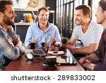 men talking at a coffee shop | Shutterstock . vector #289833002