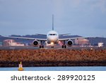 An Airplane Is Seen Here In...