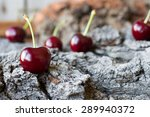 Ripe Cherry On A Background Of...