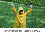 Cheerful Boy Wearing Raincoat...