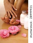 closeup of beautiful human legs and hands. human feet. SPA and wellness - stock photo