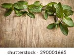 fresh mint leaves on wooden... | Shutterstock . vector #290001665