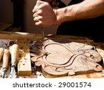 Craftsman Carving A Souvenir...