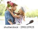 a man gives flowers beautiful...   Shutterstock . vector #290119925
