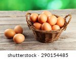 Chicken Eggs In Basket On Grey...