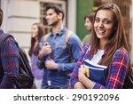 female student holding her books | Shutterstock . vector #290192096