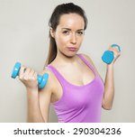 focused athletic woman wearing...   Shutterstock . vector #290304236