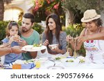 multi generation family eating... | Shutterstock . vector #290576966