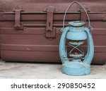 Rusty Lantern And Old Coffer
