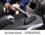 man hoovering seat of car... | Shutterstock . vector #290850902
